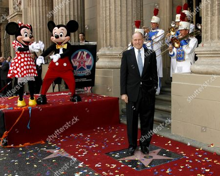 Us Cinema and Television Mogul Michael D Eisner (r) Poses During Ceremony Honoring Him with a Star On the Hollywood Walk of Fame in Los Angeles California Usa 25 April 2008 Eisner Former Executive at Abc and Later As Head of Paramount Pictures and Ceo of the Walt Disney Company Was Responsible For Television Shows 'Welcome Back Kotter' 'Happy Days' and 'Barney Miller' As Well As Films 'Raiders of the Lost Ark' 'Saturday Night Fever' and 'Grease'
