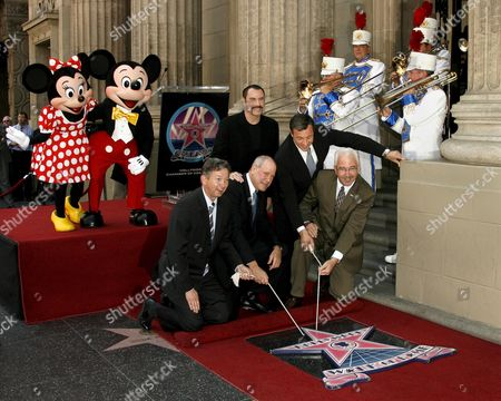 Us Actor John Travolta (c Back) Joins Hollywood Chamber of Commerce President Leron Gubler (l) Us Cinema and Television Mogul Michael D Eisner (2l) Current Ceo of Walt Disney Company Bob Iger (2r) and Chairman of the Board of the Hollywood Chamber of Commerce Mark Panatier (r) During Ceremony Honoring Eisner with a Star On the Hollywood Walk of Fame in Los Angeles California Usa 25 April 2008 Eisner Former Executive at Abc and Later As Head of Paramount Pictures and Ceo of the Walt Disney Company Helped Launch Travolta's Career with Television Shows 'Welcome Back Kotter' and Films 'Saturday Night Fever' and 'Grease'