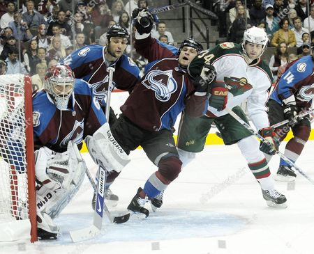 Colorado Avalanche Defenseman Adam Foote (c) Tries to Move Aaron Voros (r) of the Minnesota Wild out of the Crease and Away From Av's Goalie Jose Theodore (l) in the First Period at the Pepsi Center in Denver Colorado Usa 15 April 2008