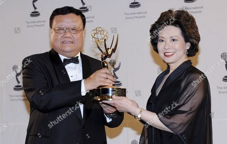 Chairman and Ceo of Phoenix Satellite Television Liu Changle (l) Wins the Directorate Award Presented by Us Labor Secretary Elaine Chao at the 36th Annual International Emmy Awards Gala in New York Usa 24 November 2008