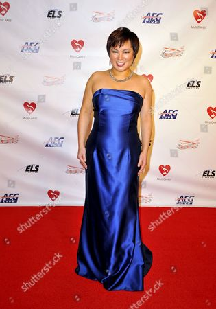 Us Pianist Angelin Chang Arrives For the Musicares Person of the Year Special Event in Los Angeles California Usa 06 February 2009 Musicares and the Recording Academy Honored Us Singer/songwriter and Actor Neil Diamond with Their 2009 Person of the Year Award For His Exceptional Artistic Achievements As Well As His Philanthropic Work