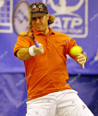 Stock Photo of Vincent Spadea of the United States Hits a Return to Chris Guccione of Australia in the First Round of the Regions Morgan Championships Tennis Tournament in Memphis Tennessee Usa 16 February 2009 Spadea Lost the Match 7-6 (1) 7-6 (5)