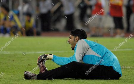 Saudi Arabia's Goalkeeper Yasser Al Mosailem Calls out in Pain Following an Injury in the Last Few Minutes of the Second Half Saudi Arabia Beat Japan 3-2 in the Asian Cup Semi Finals at My Dinh Stadium Hanoi Vietnam 25 July 2007