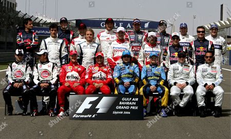Formula One Drivers Lined Up For a Group Photo Session at the Formula One Racetrack Near Manama Bahrain On Sunday 12 March 2006 the First Race of the F1 World Championship 2006 the Bahrain Grand Prix Will Take Place Here Today the First Row Left to Right: Brazilian Rubens Barrichello; British Jenson Button For Lucky Strike Honda; German Michael Schumacher Brazilian Felipe Massa For Ferrari; Spanish Fernando Alonso Italian Giancarlo Fisichella For Renault; Finnish Kimi Raikkonen Columbian Juan Pablo Montoya For Mclaren Mercedes 2nd Row L to R: Australian Mark Webber German Nico Roseberg For Williams; German Ralf Schumacher Italian Jarno Trulli For Toyota; Austrian Christian Klein Scottish David Coulthard For Red Bull Third Row L to R: Italian Vitantonio Liuzzi American Scott Speed For Toro Rosso; Japanese Takuma Sato and Yuji Ide For Super Aguri; Dutch Christijan Albers Portuguese Tiago Monteiro For Mf1 and German Nick Heidfeld and Canadian Jacques Villeneuve For Bmw Saube