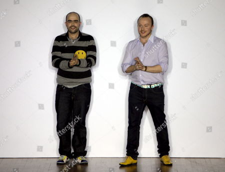 Designers Bruno Basso (l) and Christopher Brooke Applaud the Audience Following Their Show On the Second Day of London Fashion Week Britain 21 February 2009