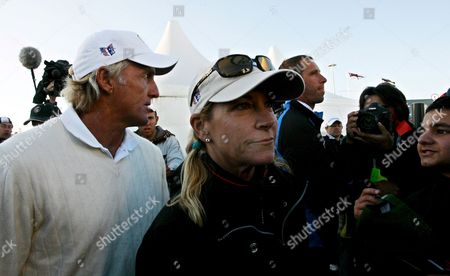 Australian Greg Norman and Wife Chris Evert Evade Photographers Outside the 18th Hole During the Third Round of the 2008 British Open Championship at Royal Birkdale Golf Club in Southport England On 19 July 2008