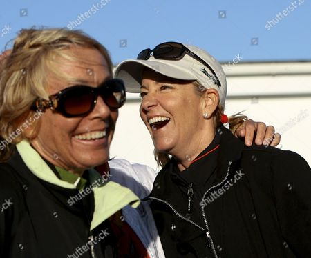 Chris Evert (r) Wife of Australian Golfer Greg Norman Laughs with a Family Friend On the 18th Hole During the Third Round of the 2008 British Open Championship at Royal Birkdale Golf Club in Southport England On 19 July 2008