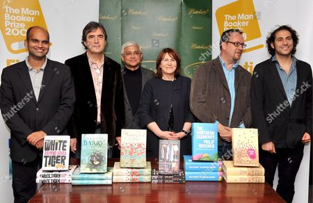 Stock Photo of Shortlisted Authors For the Man Booker Prize For Fiction (l-r) Indian Writer Aravind Adiga Irish Writer Sebastian Barry Indian Writer Amitav Ghosh English Writer Linda Grant English Writer Philip Hensher and Australian Author Steve Toltz Poze For Photographers at Hatchard's Bookshop in Central London Britain 14 October 2008 the Man Booker Prize For Fiction is the English Speaking World's Most Coveted Literary Award the Winner Will Be Announced Later On 14 October