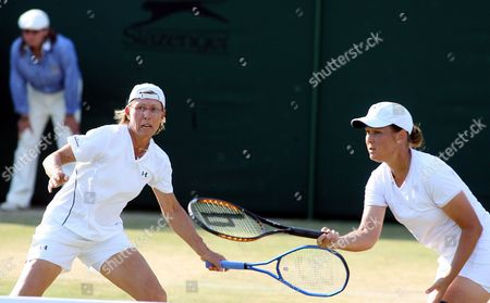 Stock Photo of Martina Navratilova (l) During Her Women's Doubles Match with Liezel Huber Against Anastasia Myskina and Elena Likhovtseva For the Wimbledon Championships at the All England Lawn Tennis Club Tuesday 04 July 2006
