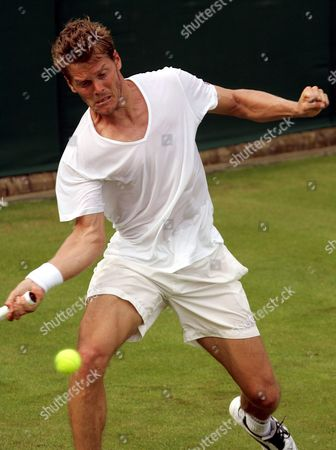 Thomas Enqvist of Sweden Delivers a Forehand Return to Hyung-taik Lee of Korea During Their First Round Match On the Opening Day of the Wimbledon Championships at the All England Lawn Tennis Club Monday 20 June 2005