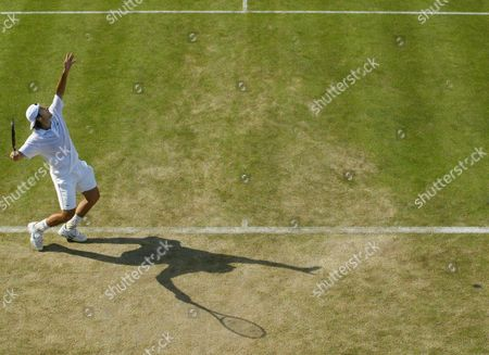 Sebastien Grosjean of France Serves to Jan-michael Gambill of the Us During Their Show Court Match at the All England Lawn Tennis Championships in Wimbledon Friday 25 June 2004