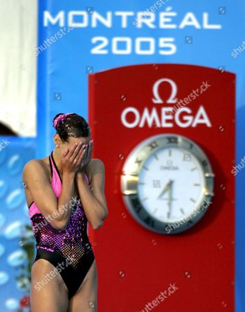 France's Virginie Dedieu Reacts to a Near-perfect Score of 99 001 in the Finals of the Synchronized Swimming-solo Competition at the Fina World Championships in Montreal Quebec Thursday 21 July 2005 Virginie Dedieu of France Won the Gold Medal Natalia Ischenko of Russia Won the Silver and Gemma Mengual of Spain Won the Bronze