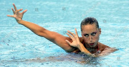 Spain's Gemma Mengual Performs During the Final Round of the Synchronized Swimming-solo Competition at the Fina World Championships in Montreal Quebec Thursday 21 July 2005 Virginie Dedieu of France Won the Gold Natalia Ischenko of Russia Won the Silver and Gemma Mengual of Spain Won the Bronze