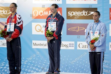 France's Virginie Dedieu (c) Shows Her Emotion Duriong the Playing of the French National Anthem After She Won the Gold Medal in the Synchronized Swimming-solo Competition at the Fina World Championships in Montreal Quebec Thursday 21 July 2005 Natalia Ischenko of Russia (l) Won the Silver and Gemma Mengual of Spain (r) Won the Bronze