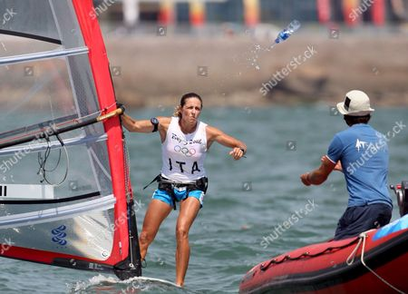 Italian Alessandra Sensini Throws a Bottle of Water Before the Race in the Womens Rs X Windsurfing Event in Qingdao China 20 August 2008 Sensini Won a Silver Medal