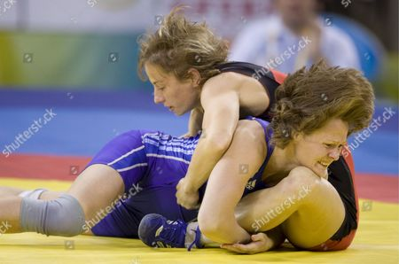 Romania's Ana Pavel (in Red) Contends with Kazakhstan's Olga Smirnova (in Blue) in the 55 Kg Repechage Round 2 of the Women's Freestyle Wrestling Competition at the Beijing University of Agriculture Gymnasium in Beijing China 16 August 2008 This is the First Olympics to Ever Feature Women's Wrestling