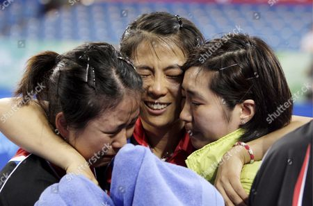 Korea's (l-r) Park Mi Young Kim Kyung Ah and Dang Ye Seo Jubilates After Winning Their Bronze Medal Against Japan Team in the Women's Table Tennis Team Bronze Medal Event During the Beijing 2008 Olympic Games at the Peking University Gymnasium Beijing China 17 August 2008 Korea Defeated Japan 3-0