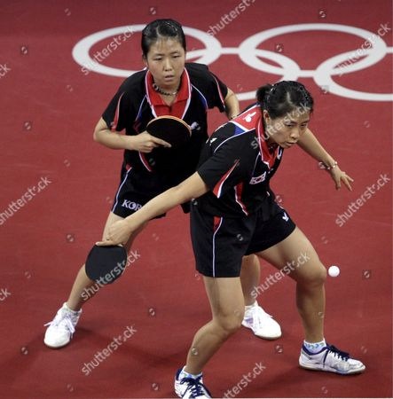 Korea's Kim Kyung Ah (r) and Park Mi Young (l) in Action Against the Us Team During the Women's Team Table Tennis Bronze Play-off Event at the Beijing 2008 Olympic Games at the Peking University Gymnasium Beijing China 16 August 2008 Korea Defeated Usa 3-0