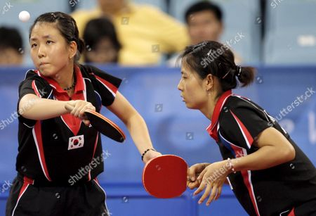 Korea's (l-r) Mi Young Park and Kyung Ah Kim in Action Against Singapore's (unseen) Jia Wei Li and Yue Gu Wang During the Semifinal Round 2 in the Women's Team Table Tennis Event During the Beijing 2008 Olympic Games at the Peking University Gymnasium Beijing China 15 August 2008