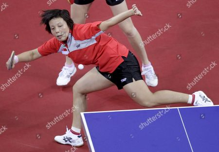 Singapore's Yue Gu Wang in Action Against Korea's (unseen) Mi Young Park and Kyung Ah Kim During the Semifinal Round 2 in the Women's Team Table Tennis Event During the Beijing 2008 Olympic Games at the Peking University Gymnasium Beijing China 15 August 2008