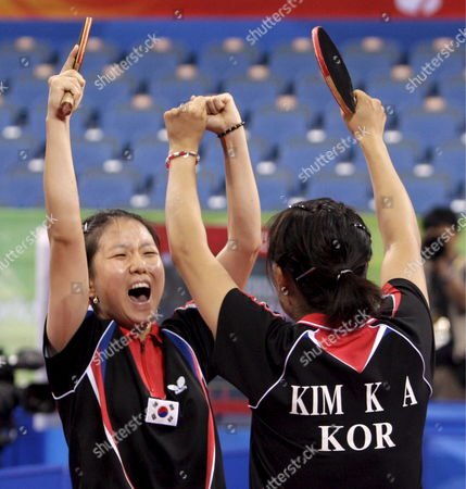 Korea's Park Mi Young (l) and Kim Kyung Ah (r) Jubilates After Winning Their Bronze Medal Against Japan Team in the Women's Table Tennis Team Bronze Medal Event During the Beijing 2008 Olympic Games at the Peking University Gymnasium Beijing China 17 August 2008 Korea Defeated Japan 3-0
