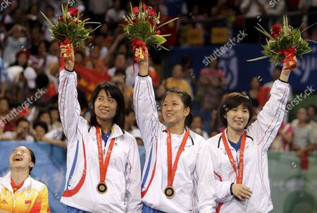 (l-r) Kim Kyung Ah Park Mi Young and Dang Ye Seo of Korea Wave to the Crowd After Winning the Bronze Medal in Women's Table Tennis Team Medal Ceremony During the Beijing 2008 Olympic Games at the Peking University Gymnasium Beijing China 17 August 2008 China Defeated Singapore to Win the Gold