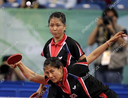 Korea's Kim Kyung Ah Park Mi Young and (facing the Camera) During Women's Table Tennis Team Bronze Medal Event During the Beijing 2008 Olympic Games at the Peking University Gymnasium Beijing China 17 August 2008 Korea Defeated Japan 3-0