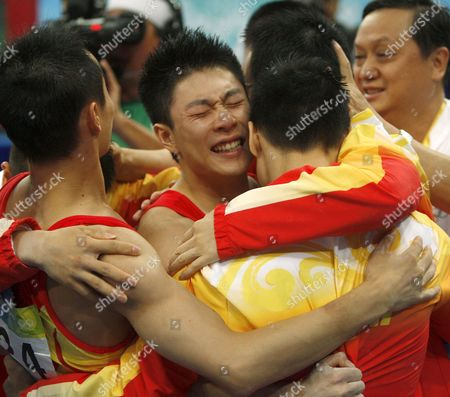 China's Li Xiaopeng (c) Xiao Qin (l) Yang Wei (r)) and Huang Xu Celebrates After Winning the Gold Medal For Artistic Gymnastics Men's Team During the Olympic Games in Beijing China 12 August 2008 the Chinese Won the Gold Medal For the Event with Japan and United States Taking Silver and Bronze Respectively