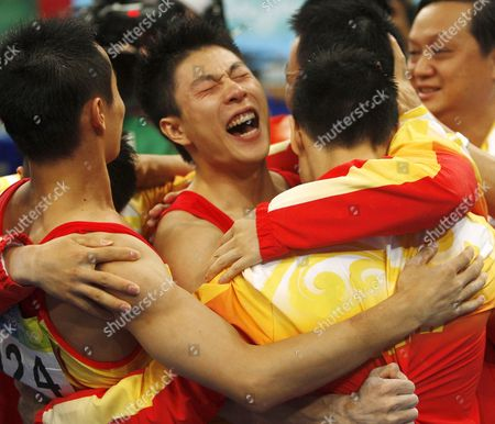 China's Xiao Qin (l) Li Xiaopong (c) Yang Wei (back) and Huang Xu Celebrates After Winning the Gold Medal For Artistic Gymnastics Men's Team During the Olympic Games in Beijing China 12 August 2008 the Chinese Won the Gold Medal For the Event with Japan and United States Taking Silver and Bronze Respectively