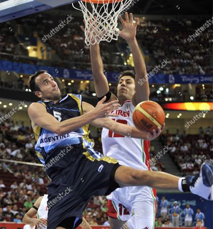 Emanuel David Ginobili of Argentina (l) Tries to Shoot While Getting Fouled by Oshin Sahakian of Iran During the Preliminary Round Basketball at the 2008 Beijing Olympic Games at Wukesong Olympic Basketball Gymnasium in Beijing China 16 August 2008