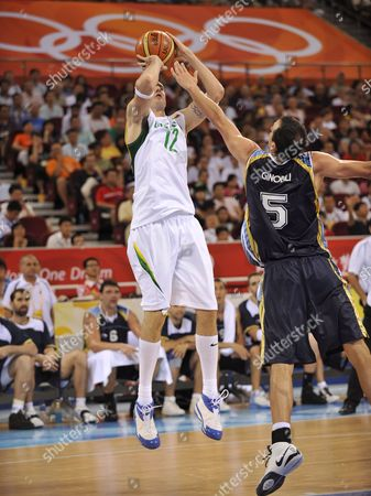 Stock Photo of Ksistof Lavrinovic of Lithuania Shoots Over Emanuel David Ginobili of Argentina During Olympic Basketball Preliminaries at Wukesong Gymnasium in Beijing China 10 August 2008 Lithuania Defeated Argentina