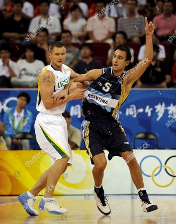 Emanuel David Ginobili of Argentian (r) Tries to Get His Teammates to Pass Him the Ball As Rimantas Kaukenas of Lithuania Defends During Olympic Basketball Preliminaries at Wukesong Gymnasium in Beijing China 10 August 2008 Lithuania Defeated Argentina