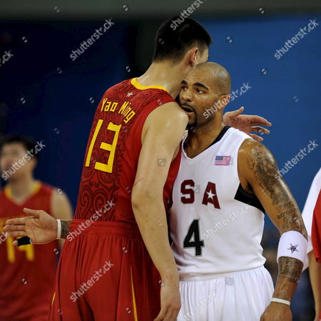 China's Yao Ming and United States Carlos Boozer Hug at the End of Their Olympic Basketball Preliminaries at Wukesong Gymnasium in Beijing China 10 August 2008 United States Won 101-70