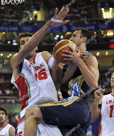 Stock Picture of Emanuel David Ginobili of Argentina (r) Goes to the Basket While Getting Fouled by Hamed Ehadadi of Iran During the Preliminary Round Basketball at the 2008 Beijing Olympic Games at Wukesong Olympic Basketball Gymnasium in Beijing China 16 August 2008
