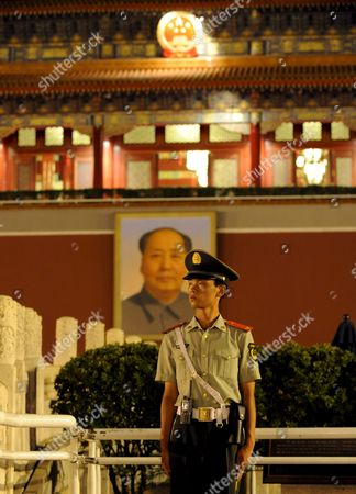 A Paramilitary Policeman Stands Guard in Front of the Portrait of Mao Tse Tung at the Gates of the Forbidden City Beijing China 05 August 2008 Epa/kay Nietfeld