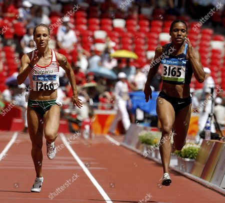 Torri Edwards of the Us (r) and Inna Eftimova of Bulgaria Compete in a Women's 100m Heat at the National Stadium During the Beijing 2008 Olympic Games Beijing 16 August 2008