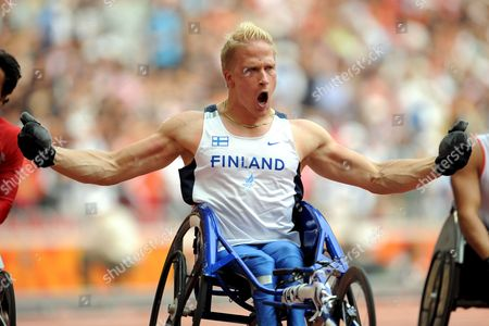 Finland's Leo-pekka Tahti Reacts After Winning the Men's 100m - T54 at the National Stadium Known As the Birds' Nest During the Beijing 2008 Paralympic Games China 16 September 2008 Tahti Won Gold Saichon Konjen of Thailand Won Silver and Supachai Koysub Also of Thailand Won the Bronze