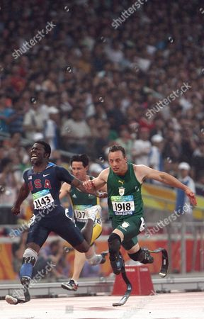 Oscar Pistorius (r) of South Africa Crosses the Finish Line Ahead of Jerome Singleton (l) of the Usa and Stephen Wilson (c) of Australia During the Men's 100m - T44 Final at the National Stadium Also Known As the Birds' Nest During the Beijing 2008 Paralympic Games China 09 September 2008 Pistorius Won the Race and Wilson Came in Second