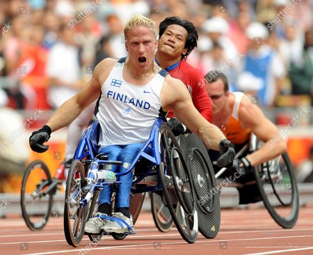 Finland's Leo-pekka Tahti (l) Crosses the Finish Line During the Men's 100m - T54 at the National Stadium Known As the Birds' Nest During the Beijing 2008 Paralympic Games China 16 September 2008 Tahti Won Gold Saichon Konjen (c) of Thailand Won Silver and Supachai Koysub Also of Thailand Won the Bronze