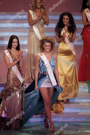Miss Italy (c) Sofia Bruscoli is Selected Miss Southern Europe As Miss Bosnia Herzegovina (l) Miss Serbia and Montenegro(r) and Miss Israel (back) Cheer During the 55th Miss World Finals in Sanya Southern China's Hainan Island Saturday 10 December 2005 Miss Iceland Unnur Birna Vilhjalmsdottir Was Crowned the 2005 Miss World From 102 Contestants
