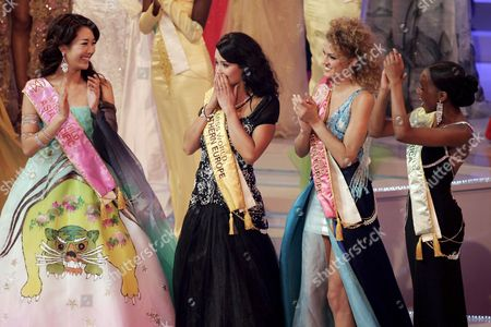 Miss Iceland (2nd L) Unnur Birna Vilhjalmsdottir is Applauded by Miss Korea (l) Eun-young Oh Miss Italy (2nd R) Sofia Bruscoli and Miss Tanzania (r) Nancy Abraham Sumary After She Was Named Miss World 2005 in Sanya On Southern China's Hainan Island Saturday 10 December 2005