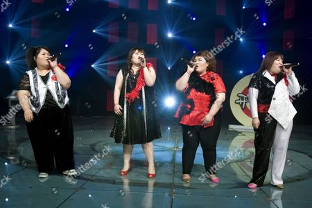 (l-r) Xiao Yang Zhang Wen Yang Ye and Shen Jing of the Band 'Qian Jin' (500 Kg) Perform During a Tv Show in Beijing On 11 May 2007 the Band's Name is an Allusion to the Combined Weight of the Four Overweight Members Xiao Yang Born with Lipometabolic Disorder Founded the Band in 2006 After She Failed to Find an Adequate Job Despite Having Graduated As the Best in Her Class to Encourage Overweight People to Feel More Comfortable