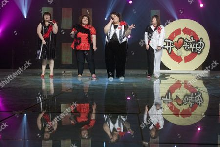 (l-r) Zhang Wen Yang Ye Xiao Yang and Shen Jing of the Band 'Qian Jin' (500 Kg) Perform During a Tv Show in Beijing On 11 May 2007 the Band's Name is an Allusion to the Combined Weight of the Four Overweight Members Xiao Yang Born with Lipometabolic Disorder Founded the Band in 2006 After She Failed to Find an Adequate Job Despite Having Graduated As the Best in Her Class to Encourage Overweight People to Feel More Comfortable