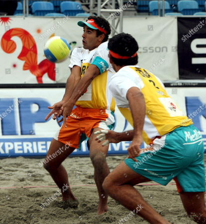 Pedro Solberg Salgado (l) and Roberto Lopes (r) of Brazil in Action During Their Match Against Dax Holdren and Sean Scott of Usa at the Beach Volleyball World Tour in Zagreb On Saturday 03 June 2006