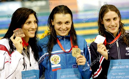 Gold Medalist Valentina Artemyeva of Russia (c) Silver Medalist Sophie De Ronchi (r) and Mirna Jukic of Austria (bronze) Show Their Medals of the Women's 100 M Breaststroke at the European Short Course Championships in Rijeka Town Croatia On 14 December 2008