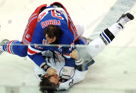New York Rangers' Aaron Voros (up) Fight For Puck with Tampa Bay Lighting Rayan Malone During the First Period of the Nhl Opening Season Game in Prague Czech Republic On 05 October 2008