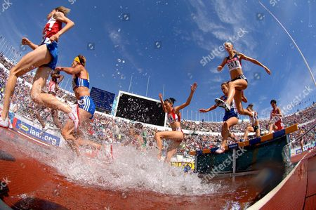 Us Elizabeth Jackson (r No 801) and Competitors in the Third Heat of the Women's 3000m Steeplechase Cross the Water Pond at the 10th Iaaf World Championships in Athletics Helsinki Finland Saturday 06 August 2005