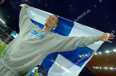 Finland's Tommi Evila Celebrates After Placing Third in the Men's Long Jump at the 10th Iaaf World Championships in Athletics Helsinki Finland Saturday 13 August 2005 Dwight Phillips of the Us Won Second Was Ignisious Gaisah of Ghana