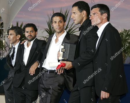 French Director Rachid Bouchareb (l) Poses with (l-r) French Actors Jamel Debbouze Sami Bouajila Roschdy Zem and Bernard Blancan After the Cast Was Awarded with the Best Actor Award After the Closing Ceremony of the 59th Cannes Film Festival Sunday 28 May 2006 in Cannes