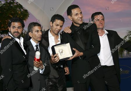 French Director Rachid Bouchareb (2nd L) Poses with (l-r) French Actors Jamel Debbouze Sami Bouajila Roschdy Zem and Bernard Blancan After the Cast Was Awarded with the Best Actor Award After the Closing Ceremony of the 59th Cannes Film Festival Sunday 28 May 2006 in Cannes
